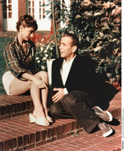 Sabrina 1954 movie Audrey Hepburn leggy pose seated next to Humphrey Bogart 8x10