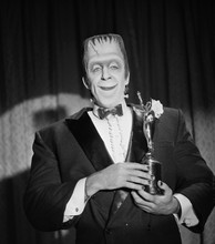 The Munsters Fred Gwynne as Herman smiling holding Emmy Award 8x10 photo