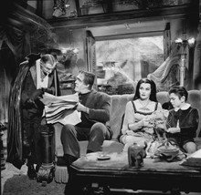 The Munsters Grandpa Herman Lily & Eddie sitting at home together 8x10 photo