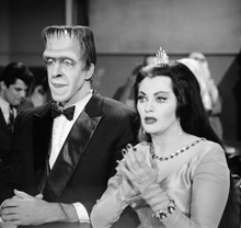 The Munsters Herman and Lily in formal dress sitting together 8x10 photo