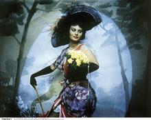 Sophia Loren in blue dress & hat holding flowers 8x10 photo