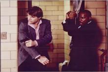 Robert Urich 8x10 photo in action holding gun Spenser For Hire 1985