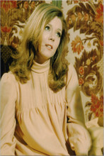Diana Rigg 8x10 photo The Avengers TV series sitting on bed in pink dress