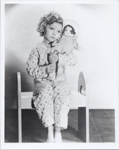 Shirley Temple cute seated pose in pajamas holding doll 8x10 photo