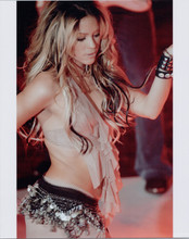 Shakira wears bra top with bare midriff in concert 8x10 press photo