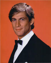 Manimal 1983 TV series Simon MacCorkindale in tuxedo red background 8x10 photo