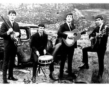 THE BEATLES JOHN PAUL RINGO & GEORGE WITH INSTRUMENTS BY OLD CAR 8X10 PHOTO