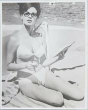 Raquel Welch sits on beach in white bikini wearing reading glasses 8x10 photo