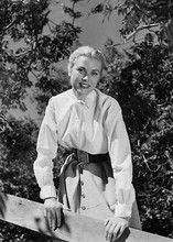 Grace Kelly poses next to fence circa 1950's Hollywood 5x7 inch photograph