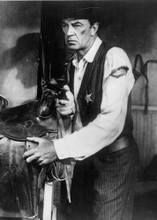 Gary Cooper as embattled Will Kane draws gun in stable High Noon 5x7 photo