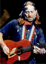 Willie Nelson 5x7 inch press photo playing his Trigger guitar on stage