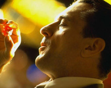 Casino movie Robert De Niro holds up red dice in profile 8x10 photo
