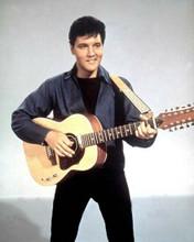 Elvis Presley smiling pose in blue shirt & black pants holding guitar 8x10 photo