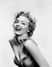 Marilyn Monroe smiling studio glamour pose with cleavage showing 8x10 photo