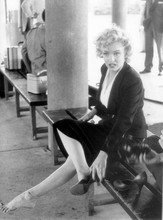 Marilyn Monroe candid takes off shoes on movie set 8x10 photo