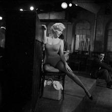 Marilyn Monroe in black stockings Yves Montand seated Let's Make Love 8x10