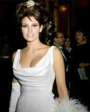 Raquel Welch wears white evening gown showing cleavage smiling 8x10 photo