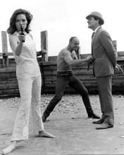 The Avengers Diana Rigg barefoot points gun Patrick Macnee on beach 8x10 photo