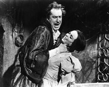 The Pit and the Pendulum Vincent Price strangles Barbara Steele 8x10 photo