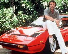 Tom Selleck sits on his red Ferrari as Thomas Magnum 8x10 photo