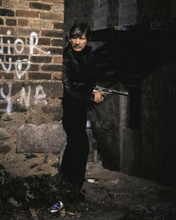 Charles Bronson holding huge gun by street corner Death Wish 3 8x10 inch photo