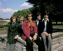The Bee Gees rare 1960's pose of the five Gibb brothers by wall 8x10 inch photo