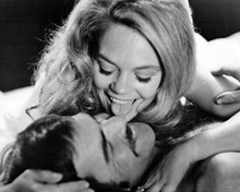 Shamus 1973 8x10 inch photo Dyan Cannon licks the face of Burt Reynolds in bed