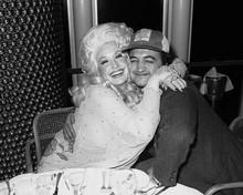 Dolly Parton hugs John Belushi at 1980 party 8x10 inch photo