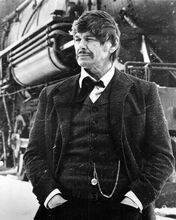 Charles Bronson as John Deakin stands in by train Breakheart Pass 8x10 photo