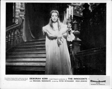 The Innocents Deborah Kerr holds candle at bottom of staircase 8x10 inch photo