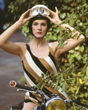 Julie Andrews sits astride motorbike in striped dress 8x10 inch photo