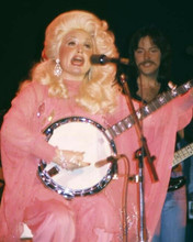 Dolly Parton 1970's in concert pose seated playing banjo on stage 8x10 photo