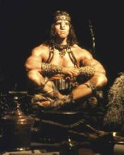 Arnold Schwarzenegger as Conan the Barbarian sitting cross-legged 8x10 photo