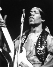 Jimi Hendrix classic in concert playing his guitar & singing 8x10 inch photo