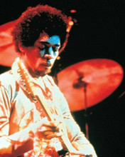 Jimi Hendrix in concert 8x10 inch photo playing guitar