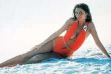 Caroline Munro wears brief red swimsuit on beach 4x6 inch photo