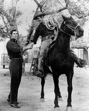 Cheyenne TV series Clint Walker shakes hands with Will Hutchins on horse 8x10
