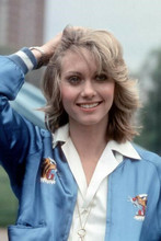 Olivia Newton John smiling pose in blue jacket hand in hair 4x6 inch photo