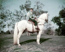 Debbie Reynolds sits astride white horse circa early 1950's 8x10 inch photo