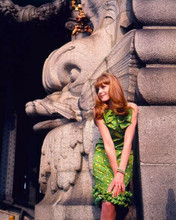 Francoise Dorleac poses in green dress by statues 1967 8x10 inch photo
