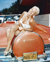 Jayne Mansfield in swimsuit poses on red Lincoln Continental 8x10 inch photo