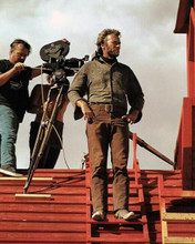 Clint Eastwood stands on red rooftop on High Plains Drifter set 1973 8x10 photo