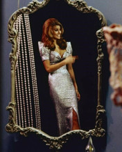 Raquel Welch 1968 pose in clingy silver gown looks in mirror 8x10 inch photo