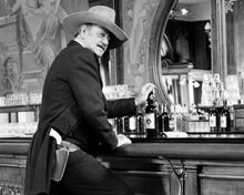 The Shootist John Wayne as Books ready for action in saloon 8x10 inch photo