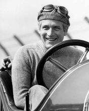 Paul Newman smiles whilst posing in vintage car wearing cap & goggles 8x10 photo
