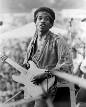 Jimi Hendrix playing his guitar at outdoor concert 8x10 inch photo