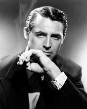 Cary Grant cool and debonair in tuxedo smoking cigarette 8x10 inch photo