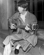 The Monkees Peter Tork in robe and slippers playing guitar 8x10 inch photo