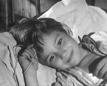Belle and Sebastian TV series Mehdi Aubry as Sebastian lying in bed 8x10 photo
