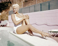 Jayne Mansfield sits on her diving board at her home pool 8x10 inch photo